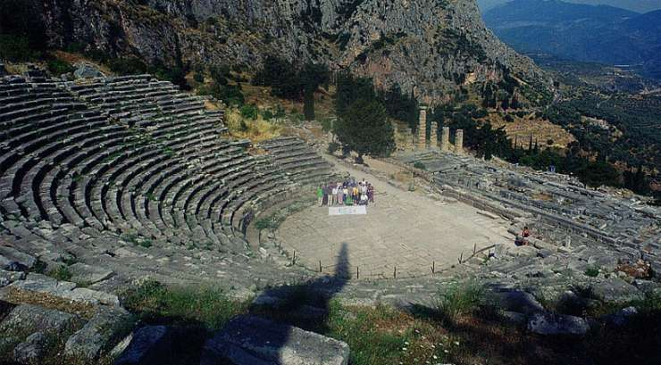 Theatre of Delphi with Apollo Temple in the background, Greece